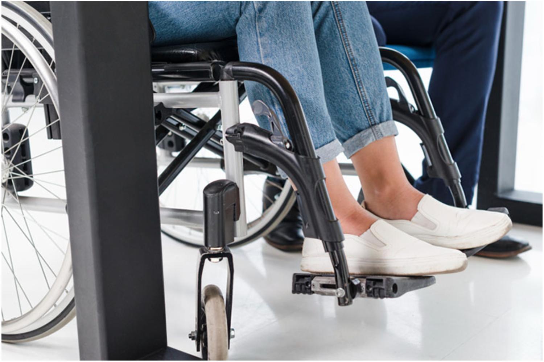 Female feet in wheelchair